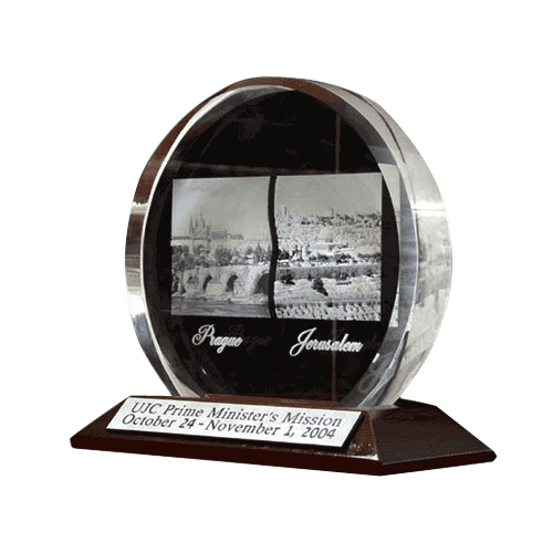 Mirror-3D-Laser-engraving-in-glass-award-on-ta wooden-base-UJC-Prime-minister.png